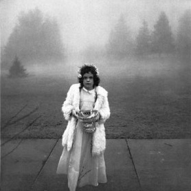 """Flower girl at a wedding"" 